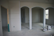 Arch way between formal living and dining rooms at front of house